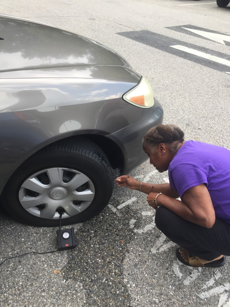 Looking at flat tire